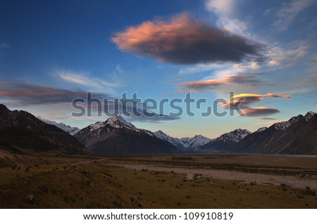 Sunrise over Mt Cook with pink cloud