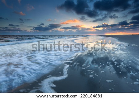 sunrise over North sea coast during low tide, Schiermonnikoog, Netherlands - stock photo