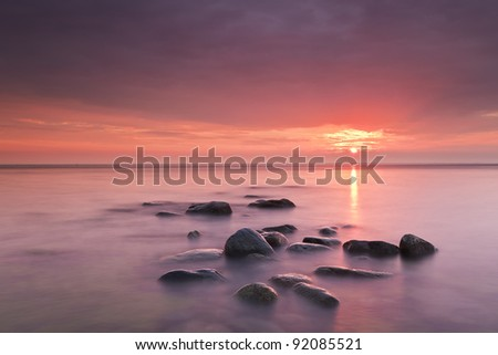 Sunrise over ocean, Scandinavia, Swede, Öland - stock photo