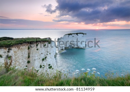 Sunrise over Old Harry Rocks - UNESCO World Heritage Site Jurassic Coast - stock photo