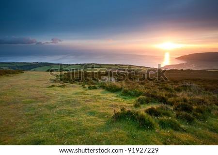 Sunrise over Porlock from Porlock Hill, Somerset, England UK - stock photo