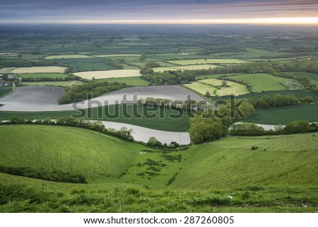 Sunrise over rolling English countryside landscape in Spring - stock photo