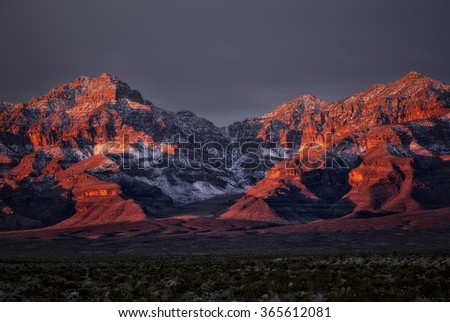Sunrise over snow dusted mountains - stock photo