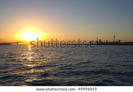Sunrise over the Auckland Harbor Bridge, Auckland City and Waitemata Harbor