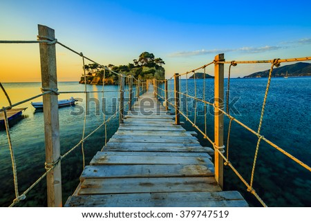 Sunrise over the bridge to Agios Sostis island on Zakynthos in Greece