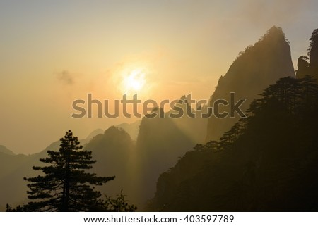 Sunrise over the Chinese mountains of Huangshan - stock photo