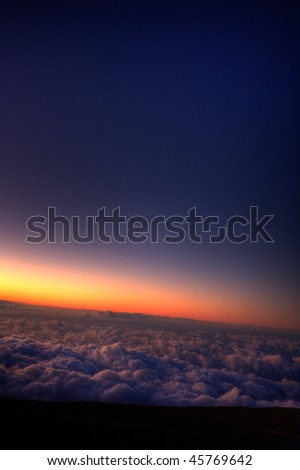 Sunrise over the clouds - stock photo