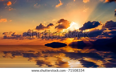 Sunrise over the Cretan land and the Mediterranean sea. - stock photo