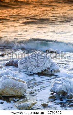 sunrise over the dead sea with water in motion blur - stock photo