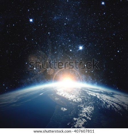 Sunrise over the Earth - Elements of this image furnished by NASA - stock photo