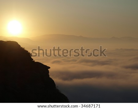 Sunrise over the foggy San Fernando Valley in Southern California. - stock photo