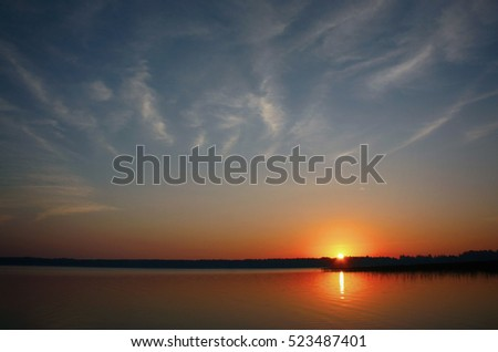 Sunrise over the lake with clouds