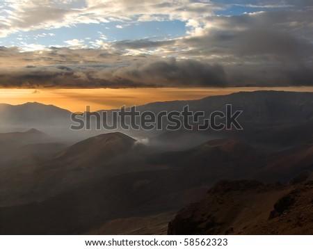Sunrise over the lunar-like landscape of the dormant Haleakala crater, Maui, Hawaii. - stock photo