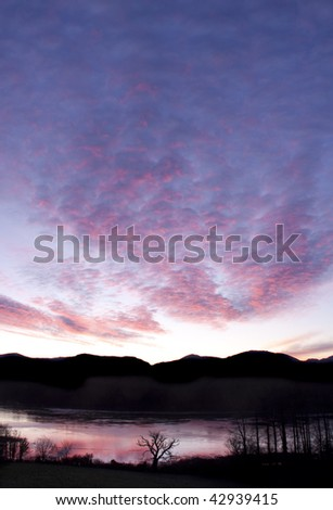 Sunrise over the Menai Bridge and Snowdonia mountain range - stock photo
