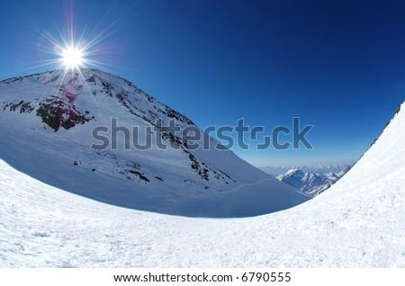 Sunrise over the mountains. Caucasus, Russia. Altitude over 5000 meters. - stock photo