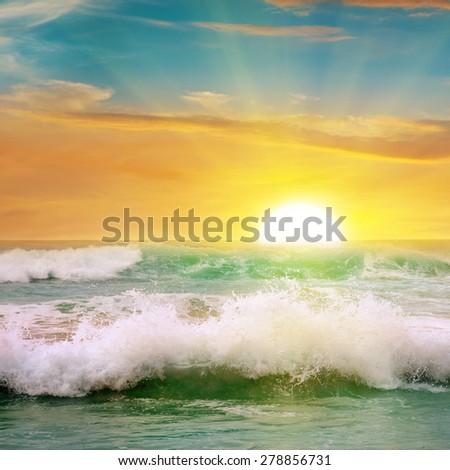 sunrise over the ocean - stock photo