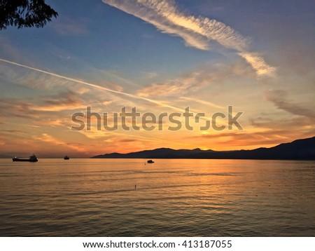 Sunrise Over the Ocean.  English Bay, Vancouver, British Columbia, Canada - stock photo