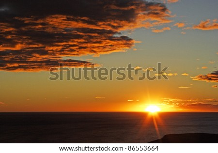 Sunrise over the Otago peninsula on the South island of New Zealand - stock photo