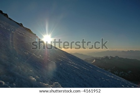 Sunrise over the planet. Caucasus mountains. Russia. - stock photo