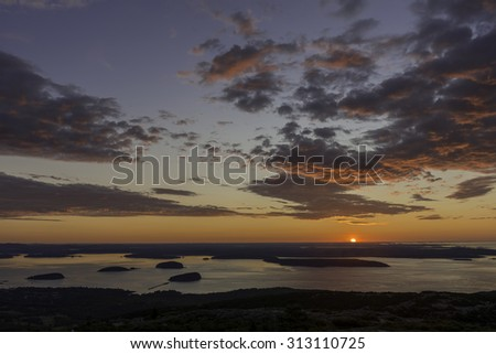 Sunrise over the Porcupine Islands and Frenchman Bay from the summit of Cadillac Mountain in Acadia National Park in Mount Desert Island, Maine