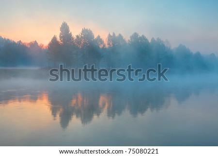 Sunrise over the river - stock photo