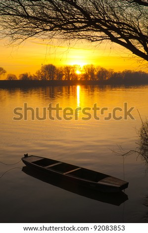 Sunrise over the river on beautiful summer day - stock photo