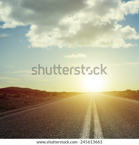 Sunrise over the road - stock photo