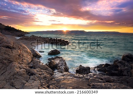 Sunrise over the rocky beach on the coast of Adriatic Sea, Istria, Croatia