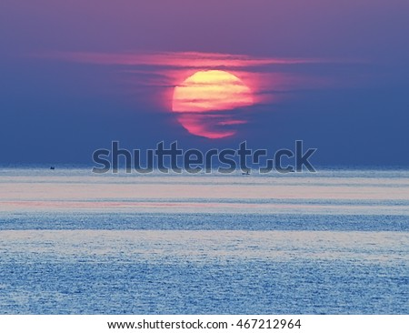 stock photo sunrise over the sea a huge bright red sun emerges from the sea in the distance small boat on the 467212964 - Каталог — Фотообои «Закаты, рассветы»