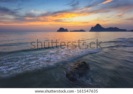 Sunrise over the sea and rock - stock photo