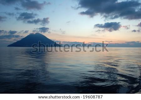 sunrise over the stromboli island - stock photo