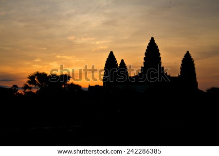 Sunrise over the towers of the ancient temple of Angkor Wat near Siem Reap, Cambodia. - stock photo