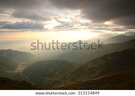 Sunrise over the valley in the Tatra Mountains. - stock photo