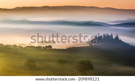 Sunrise over the valley of olive groves and vines - stock photo