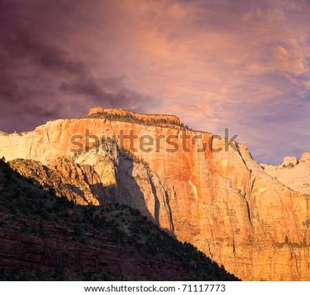 Sunrise over the West Temple Sundial peak at Zion Canyon National Park, Utah. - stock photo