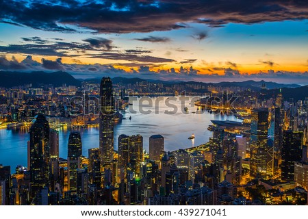 Sunrise over Victoria Harbor as viewed at Peak with Hong Kong Island and Kowloon scene