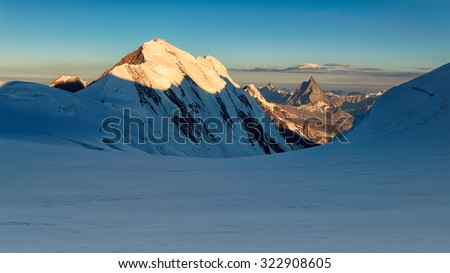 Sunrise panorama from Monte rosa glacier with view on Lyskamm and Matterhorn - stock photo