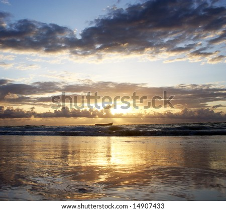 Sunrise Reflected off Indian Ocean - stock photo