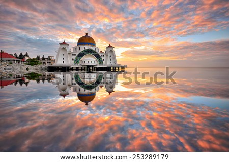Sunrise reflections at Straits Mosque, Malacca. Nature composition - stock photo