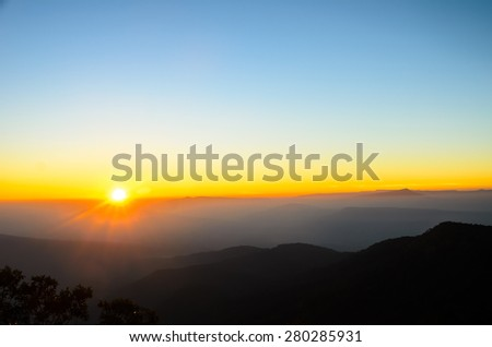 Sunrise scene with mountain and sea of mist - stock photo