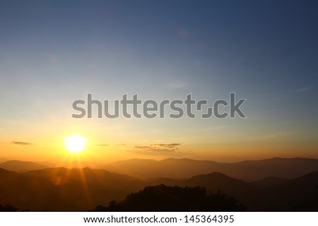 Sunrise scene with the peak and cloudscape at Phu chi fa in Chia - stock photo