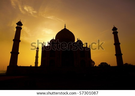 Sunrise silhouette of the Taj Mahal from the western gate. - stock photo