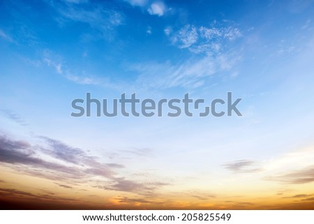 Sunrise sky blue and orange forming a border. - stock photo