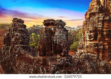 sunrise statue Bayon Temple Angkor Thom, Cambodia. Ancient Khmer architecture. - stock photo