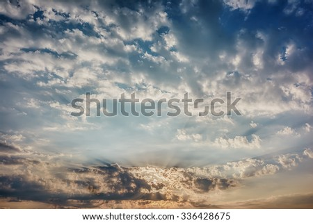 Sunrise / sunset with clouds in blue sky - stock photo