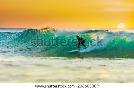 Sunrise Surfing - stock photo