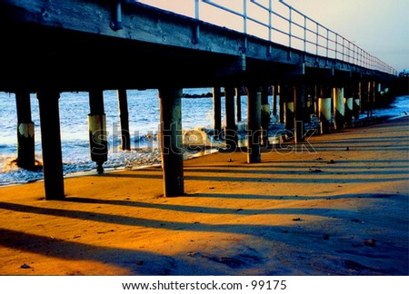 Sunrise under the boardwalk at the northern end of Atlantic City, New Jersey - stock photo