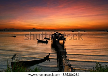 Sunrise view at fisherman jetty Jelutong, Penang Malaysia. Nature composition - stock photo