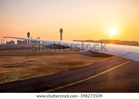 Sunrise view at the japan airport from the airplane. - stock photo