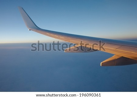 Sunrise view from an aircraft - Never forget to book a seat by the window - stock photo